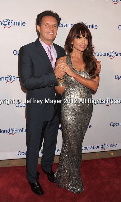 BEVERLY HILLS, CA - SEPTEMBER 28: Mark Burnett and Roma Downey attend Operation Smile's 30th Anniversary Smile Gala - Arrivals at The Beverly Hilton Hotel on September 28, 2012 in Beverly Hills, California.