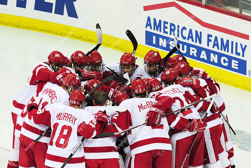 The University of Wisconsin men's hockey team huddles before the game against Minnesota on Friday at the Kohl Center in Madison