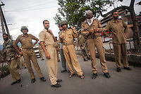 Srinagar, India-August 8, 2010: Indian police and military personell guard a street in downtown Srinagar during a stand-off with protesters