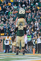 Baylor offensive tackle Spencer Drango (58) and running back Devin Chafin (28) celebrates touchdown during NCAA football game, Saturday, November 01, 2014 in Waco, Tex. (Mo Khursheed/TFV Media via AP Images)
