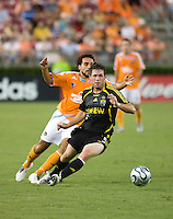 Columbus Crew midfielder Danny O'Rourke (5) dribbles away from Houston Dynamo midfielder Dwayne De Rosario (14). The Houston Dynamo tied the Columbus Crew 1-1 in a regular season MLS match at Robertson Stadium in Houston, TX on August 25, 2007.