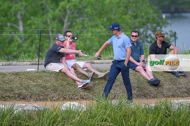 Justin Rose (GBR) high fives a fan with his putter grip as he walks around the lake to the green on 11 during day 3 of the WGC Dell Match Play, at the Austin Country Club, Austin, Texas, USA. 3/29/2019.<br /> Picture: Golffile   Ken Murray<br /> <br /> <br /> All photo usage must carry mandatory copyright credit (© Golffile   Ken Murray)