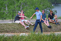 Justin Rose (GBR) high fives a fan with his putter grip as he walks around the lake to the green on 11 during day 3 of the WGC Dell Match Play, at the Austin Country Club, Austin, Texas, USA. 3/29/2019.<br /> Picture: Golffile | Ken Murray<br /> <br /> <br /> All photo usage must carry mandatory copyright credit (© Golffile | Ken Murray)