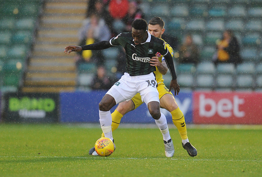 Plymouth Argyle's Freddie Ladapo under pressure from Fleetwood Town's Ashley Eastham<br /> <br /> Photographer Kevin Barnes/CameraSport<br /> <br /> The EFL Sky Bet League One - Plymouth Argyle v Fleetwood Town - Saturday 24th November 2018 - Home Park - Plymouth<br /> <br /> World Copyright © 2018 CameraSport. All rights reserved. 43 Linden Ave. Countesthorpe. Leicester. England. LE8 5PG - Tel: +44 (0) 116 277 4147 - admin@camerasport.com - www.camerasport.com