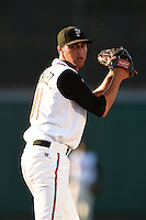 Lansing Lugnuts pitcher Alonzo Gonzalez (11) gets ready to deliver a pitch during a game against the South Bend Silver Hawks on June 6, 2014 at Cooley Law School Stadium in Lansing, Michigan.  South Bend defeated Lansing 13-5.  (Mike Janes/Four Seam Images)