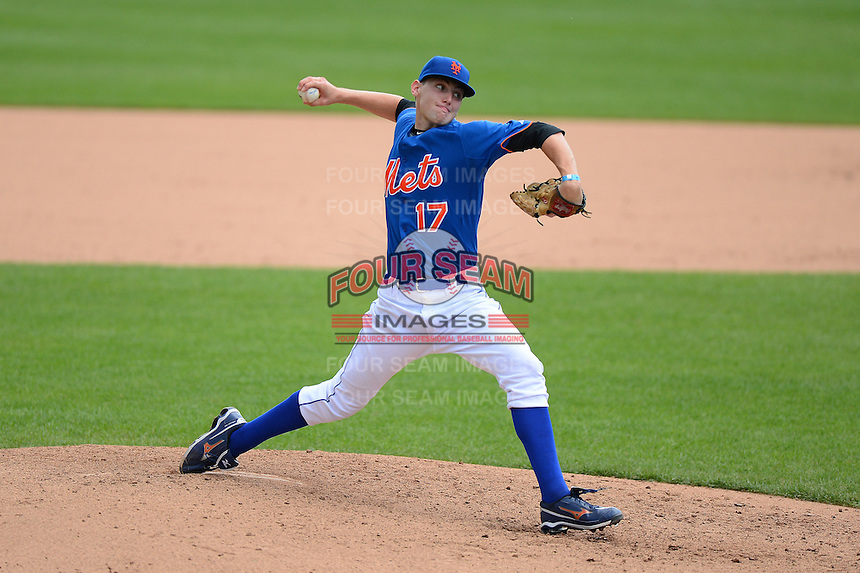 Pitcher David Burkhalter (17) of Ruston High School in Ruston, Louisiana playing for the New York Mets scout team during the East Coast Pro Showcase on August 1, 2013 at NBT Bank Stadium in Syracuse, New York.  (Mike Janes/Four Seam Images)
