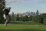 Seattle, West Seattle Golf Course, view of the Seattle skyline from the 15th Green, Washington State, Pacific Northwest, USA, golfer, Greg Arnold, teeing off, model released,.
