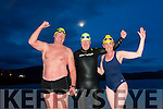 Kevin Williams, Thomas Brosnan and Mags O'Sullivan  at the Tralee Bay Swimming Club Darkness into Light Swim in aid of Pieta House at 5am in Fenit on Saturday
