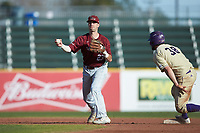Matt Cuppari (23) of the Saint Joseph's Hawks holds on to the ball after forcing out Luke Robinson (38) of the Western Carolina Catamounts at second base at TicketReturn.com Field at Pelicans Ballpark on February 23, 2020 in Myrtle Beach, South Carolina. The Hawks defeated the Catamounts 9-2. (Brian Westerholt/Four Seam Images)