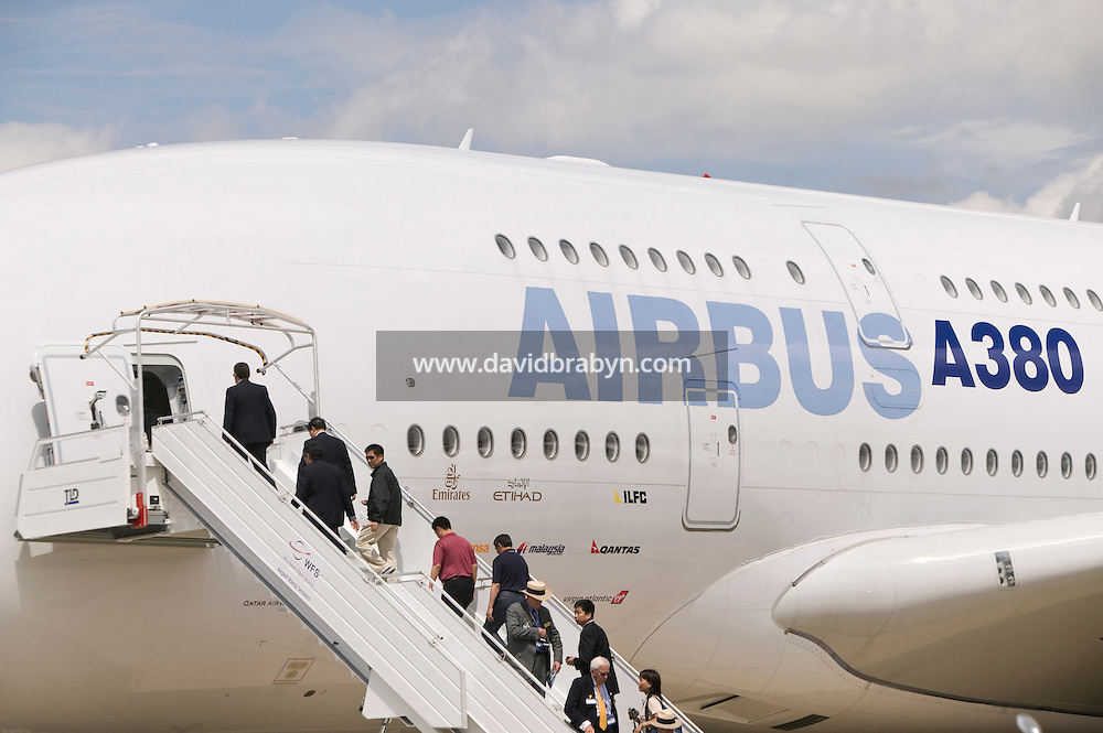 Visitors walk up an access staircase to an Airbus A380 standing on display at the Le Bourget airfield near Paris, France, after taking a tour during the first professionals-only day of the International Paris Air Show, 18 June 2007.
