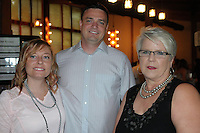 Marisa (from left) and Jake Ladue and volunteer Lisa Darling enjoy the Red, White and Baby Blue event benefitting the Jackson Graves Foundation hosted at The Garden Room on June 24.