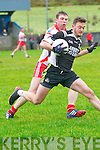 An Ghaeltacht Tomas ÓSé tackling Ardfert Rory Horgan during the County Senior Football League Div.2 play off at Annascaul GAA Grounds on Sunday afternoon.