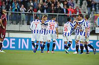 VOETBAL: HEERENVEEN: Abe Lenstra Stadion, 02-08-2012, Europa League, SC Heerenveen - Rapid Boekarest, Eindstand 4-0, Van La Parra (#7), Filip Djuricic (#9) scoorde zijn tweede treffer, Oussama Tannane (#30), Pele van Anholt (#46), Gianni Gianni Zuiverloon (#2), Marten de Roon (#15), Jukka Raitala (#20), ©foto Martin de Jong
