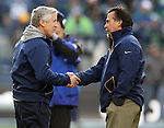 Seattle Seahawks Head Coach Pete Carroll, left, greets St. Louis Rams Head Coach Jeff Fisher before their game at CenturyLink Field in Seattle, Washington on December 30, 2012.   The Seahawks came from behind to beat the Rams 20-13.     © 2102.  Jim Bryant Photo. All Rights Reserved.