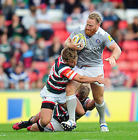 Ross Batty of Bath Rugby is double-tackled. Aviva Premiership match, between Leicester Tigers and Bath Rugby on September 25, 2016 at Welford Road in Leicester, England. Photo by: Patrick Khachfe / Onside Images