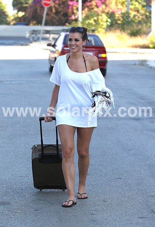 **ALL ROUND EXCLUSIVE PICTURES FROM SOLARPIX.COM**                                             **WORLDWIDE SYNDICATION RIGHTS**                                                                                  Caption: Imogen Thomas pictured leaving the Sisu Boutique Hotel in Puerto Banus, Marbella. Imogen is in Spain shooting her 2012 calendar.                                                                               This pic: Imogen Thomas                                                                                             JOB REF: 13794 AB1  SF      DATE: 31_07_2011                                                           **MUST CREDIT SOLARPIX.COM OR DOUBLE FEE WILL BE CHARGED**                                                                      **MUST AGREE FEE BEFORE ONLINE USAGE**                               **CALL US ON: +34 952 811 768 or LOW RATE FROM UK 0844 617 7637**