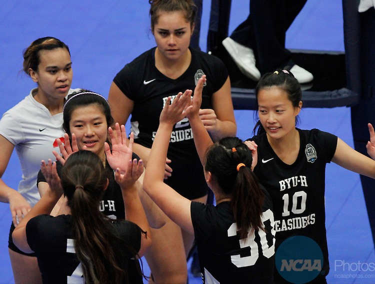 14 DEC 2013 BYU-Hawaii celebrates a point during the Division II Women's Volleyball Championship game held at the U.S. Cellular Center in Cedar Rapids, IA.  Concordia-St. Paul won over BYU-Hawaii in 3 straight sets to claim the championship title. <br /> Conrad Schmidt/NCAA Photos