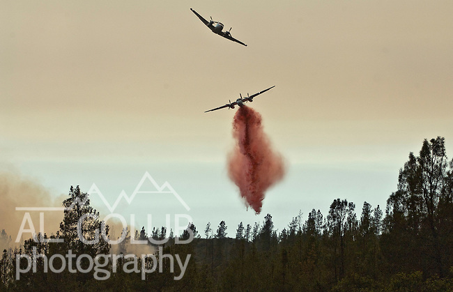 Greeley Hill, California-- July 29, 2008-Telegraph Fire-Wildfires Threaten Yosemite National Park .Guide plane leads retardant bomber on Division M of the Telegraph Fire in an attempt to slow down the progression of the fire up Halls Gulch toward Greeley Hill community. The is the active edge of the fire. .This Image was use by Associated Press Photo'.AP Photo/Al Golub.