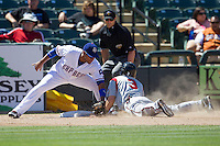 Round Rock third baseman Yangervis Solarte (26) tags out Nashville Sounds baserunner Scooter Gennett at third base in the Pacific Coast League baseball game on May 5, 2013 at the Dell Diamond in Round Rock, Texas. Round Rock defeated Nashville 5-1. (Andrew Woolley/Four Seam Images).
