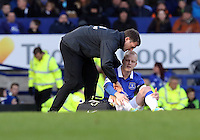 Pictured: Steven Naismith of Everton injured on the ground. Sunday 16 February 2014<br />