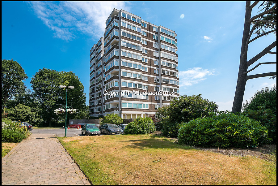 BNPS.co.uk (01202 558833)Pic: JacksonStops/BNPS<br /> <br /> Oh I say...what a view!!<br /> <br /> This unassuming apartment block is sure to be a big hit among tennis fans - as it provides stunning view's over the Wimbledon championships.<br /> <br /> A third floor flat in up market Burghley House has come on to the market for £800,000, directly overlooking the All England Lawn Tennis Club. <br /> <br /> From the balcony, there are fantastic views of the showpiece No 1 Court and Centre Court which are less than a mile away from the front door.<br /> <br /> In addition, the uncovered outside courts are in clear sight so the owner can watch the action without paying for entry.