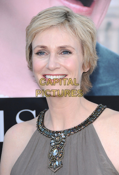 "JANE LYNCH .at The Columbia Pictures' Screening of  ""Julie & Julia"" held at The Mann's Village Theatre in Westwood, California, USA, July 27th 2009.                                                                   .portrait headshot jewel encrusted embellished grey gray khaki brown .CAP/DVS.©DVS/RockinExposures/Capital Pictures"