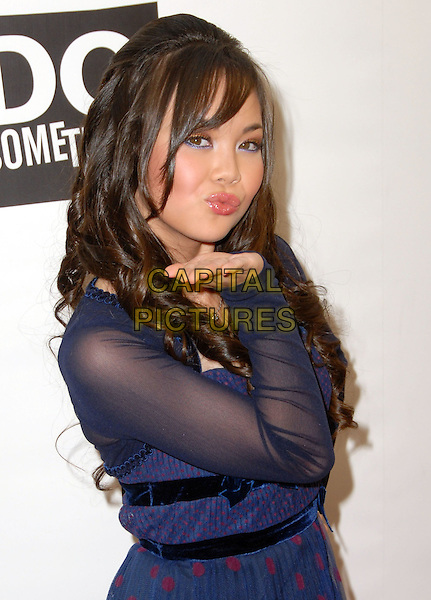 ANNA MARIE PEREZ DE TAGLE .The Do Something Awards, Official Pre-Party of Teen Choice 2008 Awards held at Level 3, Hollywood, California, USA, .02 August 2008..half length blue sheer hand blowing kiss gesture .CAP/ADM/FS.©Faye Sadou/Admedia/Capital Pictures