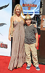 Charlotte Ross and son arriving at Twentieth Century Fox Los Angeles premiere of How To Train Your Dragon 2 held at Regency Village Theater June 8,, 2014.