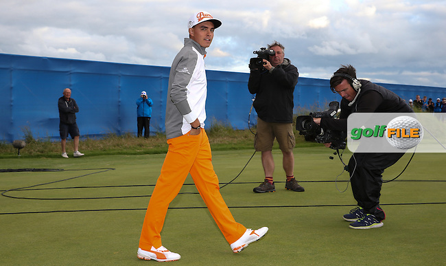Rickie Fowler (USA) takes hi walk on to the 18th to receive winner's trophy after the Final Round of the 2015 Aberdeen Asset Management Scottish Open, played at Gullane Golf Club, Gullane, East Lothian, Scotland. /12/07/2015/. Picture: Golffile | David Lloyd<br /> <br /> All photos usage must carry mandatory copyright credit (&copy; Golffile | David Lloyd)