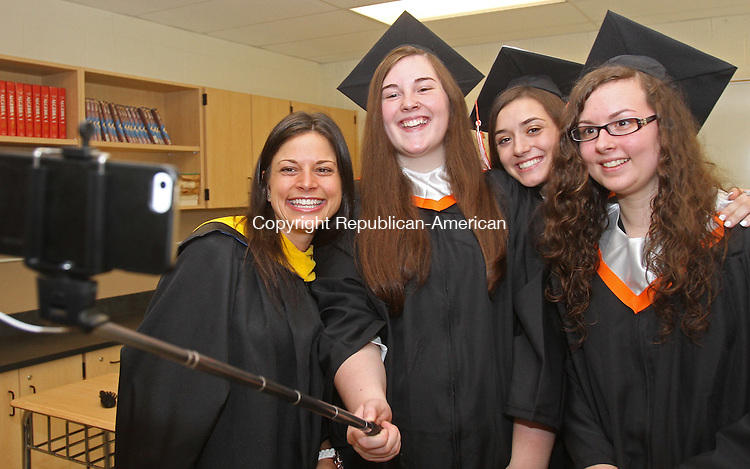 Watertown, CT-061915MK09 (from left) Jessica Fagan, Rachel Bauffard, Sabina Barbino and Alysa Caporuscio mug for their camera before the 2015 Commencement Exercises at Watertown High School Friday evening. Michael Kabelka / Republican-American