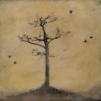Mixed media encaustic photo painting of bare tree and crows with golden autumn sky.