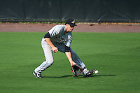 Akron RubberDucks center fielder Bradley Zimmer (6) fields a ground ball during the second game of a doubleheader against the Bowie Baysox on June 5, 2016 at Prince George's Stadium in Bowie, Maryland.  Bowie defeated Akron 12-7.  (Mike Janes/Four Seam Images)