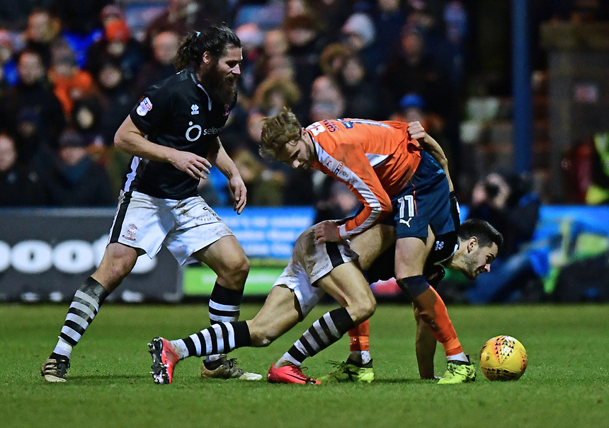 Lincoln City's Sam Habergham vies for possession with Luton Town's Andrew Shinnie<br /> <br /> Photographer Chris Vaughan/CameraSport<br /> <br /> The EFL Sky Bet League Two - Luton Town v Lincoln City - Monday 1st January 2018 - Kenilworth Road - Luton<br /> <br /> World Copyright &copy; 2018 CameraSport. All rights reserved. 43 Linden Ave. Countesthorpe. Leicester. England. LE8 5PG - Tel: +44 (0) 116 277 4147 - admin@camerasport.com - www.camerasport.com