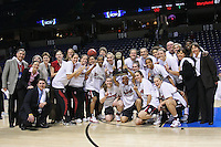 31 March 2008: Bob Bowlsby, Dr. Elaine Lambert, Eileen Roche, Kelly Clark, Evan Unrau, Amy Tucker, Jamie Zink, Michelle Harrison, two team managers, Candice Wiggins, Kayla Pedersen, Jillian Harmon, Ashley Cimino, Cissy Pierce, Jayne Appel, Scott Schuhmann, Kate Paye, Marcella Shorty, Bobby Kelsey, Tara VanDerveer, Aaron Juarez, Jeanette Pohlen, Rosalyn Gold-Onwude, Hannah Donaghe, Morgan Clyburn, Melanie Murphy, and JJ Hones pose with the trophy after Stanford's 98-87 win over the University of Maryland in the elite eight game of the NCAA Division 1 Women's Basketball Championship in Spokane, WA.