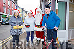 Father Christmas on a pre Christmas visit to Cahersiveen ahead of his visit on Saturday 7th December pictured here with l-r; Teresa Walsh, Anne Greaney, Santa & Michael O'Connor.