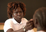 Nurse Mary Adut Muorde examines a girl in the clinic of the Loreto School outside Rumbek, South Sudan. The school is run by the Institute for the Blessed Virgin Mary--the Loreto Sisters--of Ireland. Muorde is a graduate of the Catholic Health Training Institute in Wau, South Sudan.