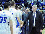 February 28, 2015 - Colorado Springs, Colorado, U.S. -  Utah State's retiring head coach, Stew Morrill, shakes hands with Air Force players following an NCAA basketball game between the Utah State Aggies and the Air Force Academy Falcons at Clune Arena, U.S. Air Force Academy, Colorado Springs, Colorado.   Utah State defeats Air Force 74-60.