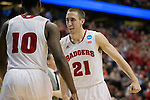 Wisconsin Badgers teammates Josh Gasser (21) and Nigel Hayes (10) celebrate a play during  a regional semifinal NCAA college basketball tournament game against the Baylor Bears Thursday, March 27, 2014 in Anaheim, California. The Badgers won 69-52. (Photo by David Stluka)