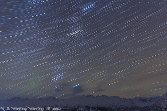 winter landscape of night sky Star trails overh Talkeetna mountains.  Southcentral, Alaska in the Glacier View/Eureka area