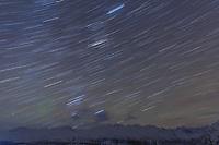 winter landscape of night sky Star trails overh Talkeetna mountains.  Southcentral, Alaska in the Glacier View/Eureka area