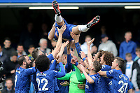 Chelsea's Gary Cahill is thrown into the air by his Chelsea teammates on the pitch at the final whistle during Chelsea vs Watford, Premier League Football at Stamford Bridge on 5th May 2019