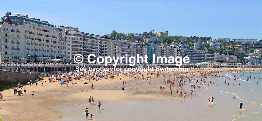 Bathers, sun worshippers, Bahia de la Concha, Sea-shell Bay, San Sebastian, Donostia, Spain, May, 2015, 201505101019<br /> <br /> <br /> <br /> Copyright Image from Victor Patterson, 54 Dorchester Park, Belfast, UK, BT9 6RJ<br /> <br /> t: +44 28 9066 1296<br /> m: +44 7802 353836<br /> vm +44 20 8816 7153<br /> <br /> e1: victorpatterson@me.com<br /> e2: victorpatterson@gmail.com<br /> <br /> www.victorpatterson.com<br /> <br /> IMPORTANT: Please see my Terms and Conditions of Use at www.victorpatterson.com