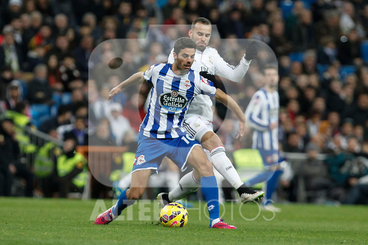 Real Madrid´s Jese Rodriguez (R) and Deportivo de la Coruna´s Juan Dominguez during La Liga match at Santiago Bernabeu stadium in Madrid, Spain. February 14, 2015. (ALTERPHOTOS/Victor Blanco)