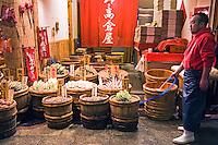 """Nishiki Market Pickle Vendor. Various kinds of fresh foods including many Kyoto specialties such as pickles, Japanese sweets,  sushi, and fresh seafood and vegetables are sold.  Known as """"Kyoto's Kitchen"""" Nishiki Market has a history of several centuries and many stores have been operated by the same families for generations."""
