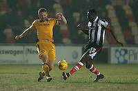 Darren Jones of Newport County and Akwasi Asante of Grimsby during the Sky Bet League 2 match between Newport County and Grimsby Town at Rodney Parade, Newport, Wales on 14 February 2017. Photo by Mark  Hawkins / PRiME Media Images.