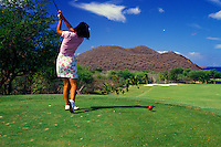 Woman playing golf on Prince Golf Course on island of Maui