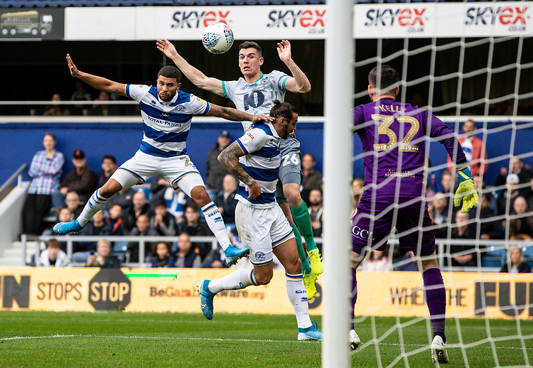 Blackburn Rovers' Darragh Lenihan (centre) competing in the air with Queens Park Rangers' Nahki Wells (left) <br /> <br /> Photographer Andrew Kearns/CameraSport<br /> <br /> The EFL Sky Bet Championship - Queens Park Rangers v Blackburn Rovers - Saturday 5th October 2019 - Loftus Road - London<br /> <br /> World Copyright © 2019 CameraSport. All rights reserved. 43 Linden Ave. Countesthorpe. Leicester. England. LE8 5PG - Tel: +44 (0) 116 277 4147 - admin@camerasport.com - www.camerasport.com