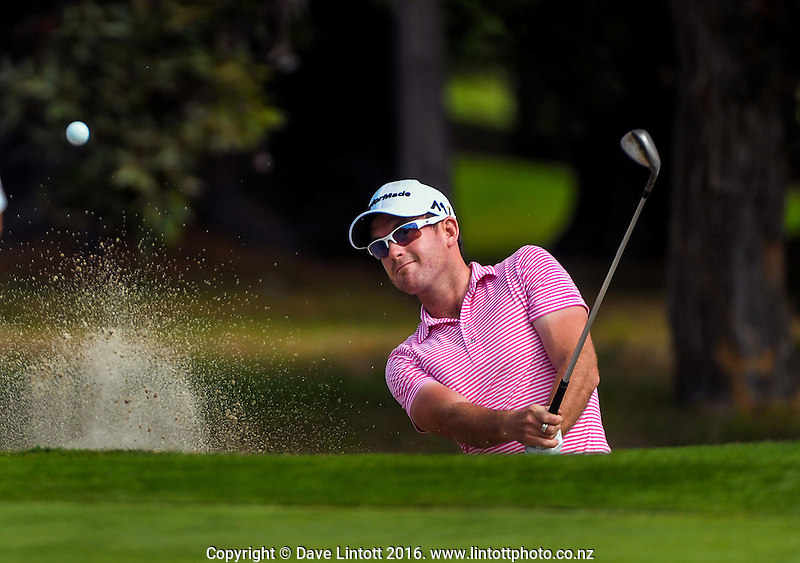 Josh Geary plays out of a bunker on the 18th. The final day of the Jennian Homes Charles Tour Lawnmaster Classic Manawatu Open at Manawatu Golf Club, Palmerston North, New Zealand on Saturday, 20 March 2016. Photo: Dave Lintott / lintottphoto.co.nz