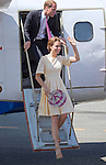 """CATHERINE, DUCHESS OF CAMBRIDGE AND PRINCE WILLIAM.arrive back at Honiara Airport after spending the night in Tuvanipupu, Solomon Islands_18/09/2012.Kate appears to be using a locally made fan to keep her cool..Mandatory credit photo: ©Dunlea/DIASIMAGES..""""NO UK USE FOR 28 DAYS"""" ..(Failure to credit will incur a surcharge of 100% of reproduction fees)..                **ALL FEES PAYABLE TO: """"NEWSPIX INTERNATIONAL""""**..IMMEDIATE CONFIRMATION OF USAGE REQUIRED:.DiasImages, 31a Chinnery Hill, Bishop's Stortford, ENGLAND CM23 3PS.Tel:+441279 324672  ; Fax: +441279656877.Mobile:  07775681153.e-mail: info@newspixinternational.co.uk"""