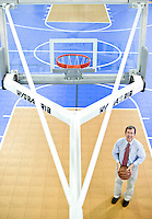 TROSA's In-kind department manager, Greg Finn, demonstates the benefits of in-kind donations. These basketball hoops and many other aspects of TROSA's gym were donated.